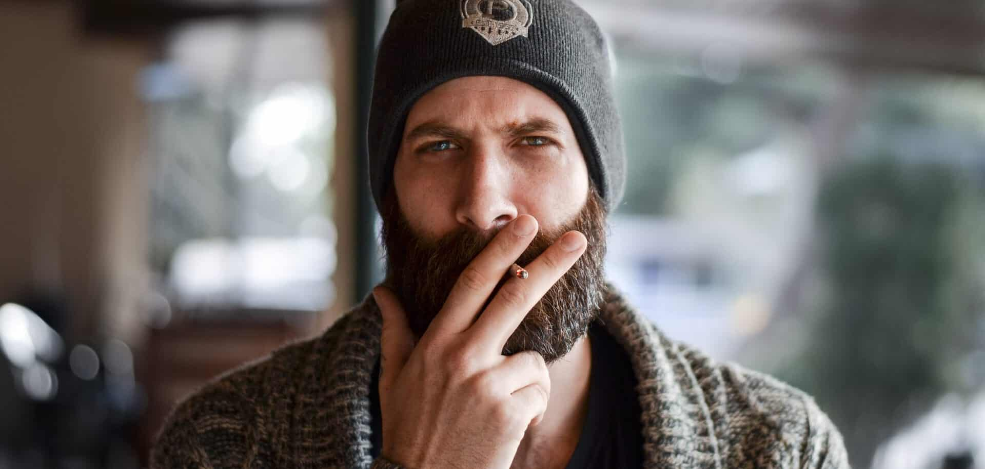 Hipster with beard and cigarette