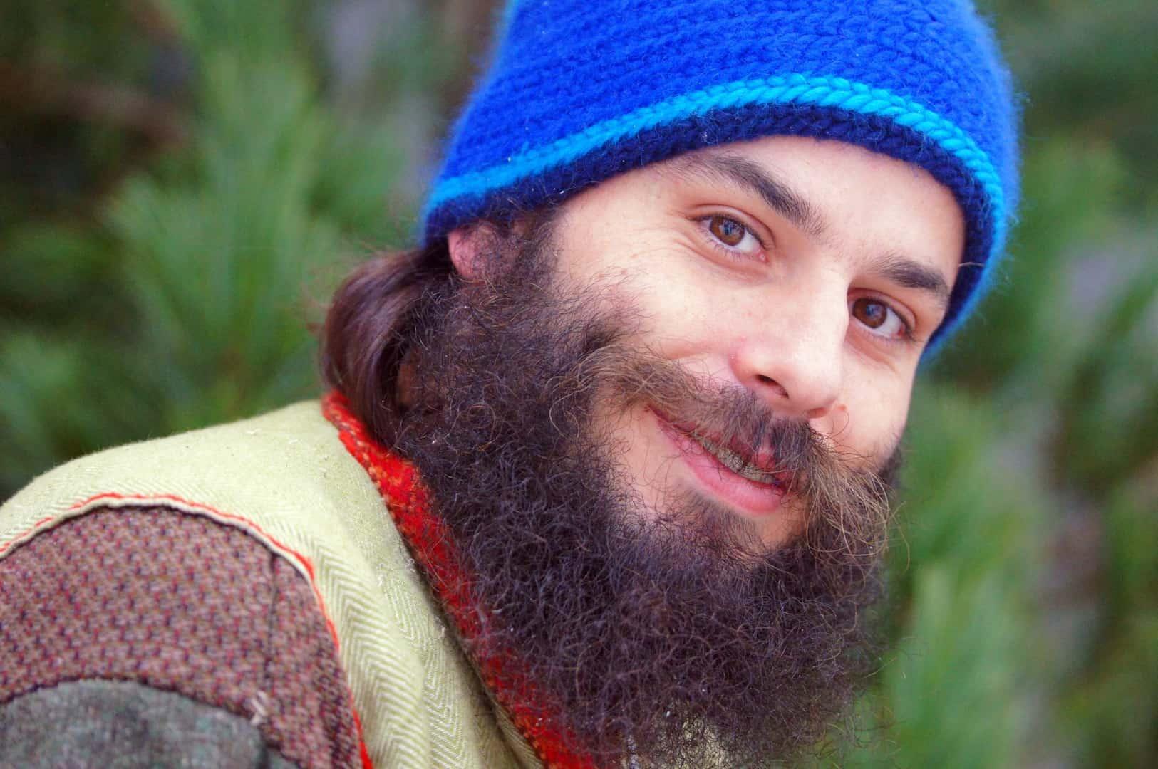 Man with curly beard