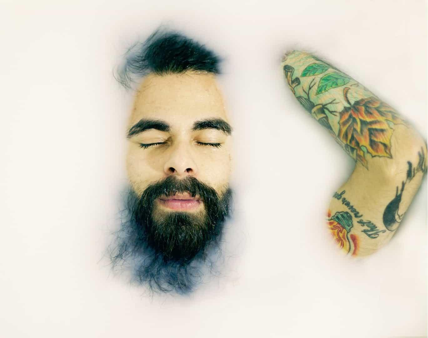 Man with beard in bath