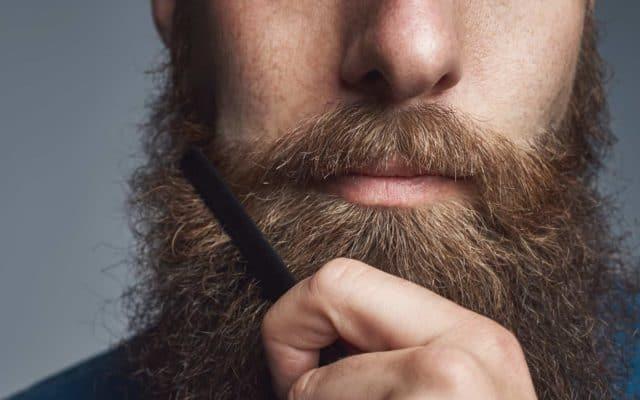 Man combs beard